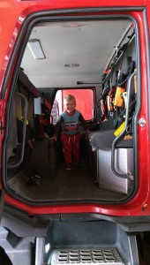 Joseph in the rear of a Fire Engine.